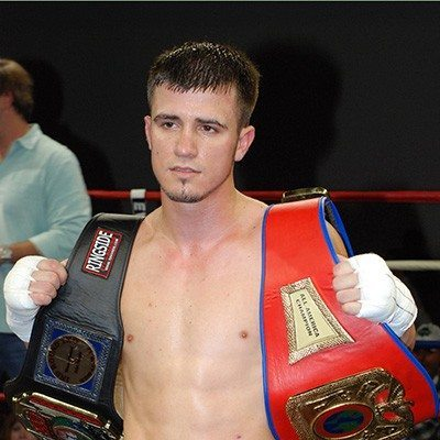 Mason Menard, professional boxer and personal trainer at Red's, with boxing tilt belts.